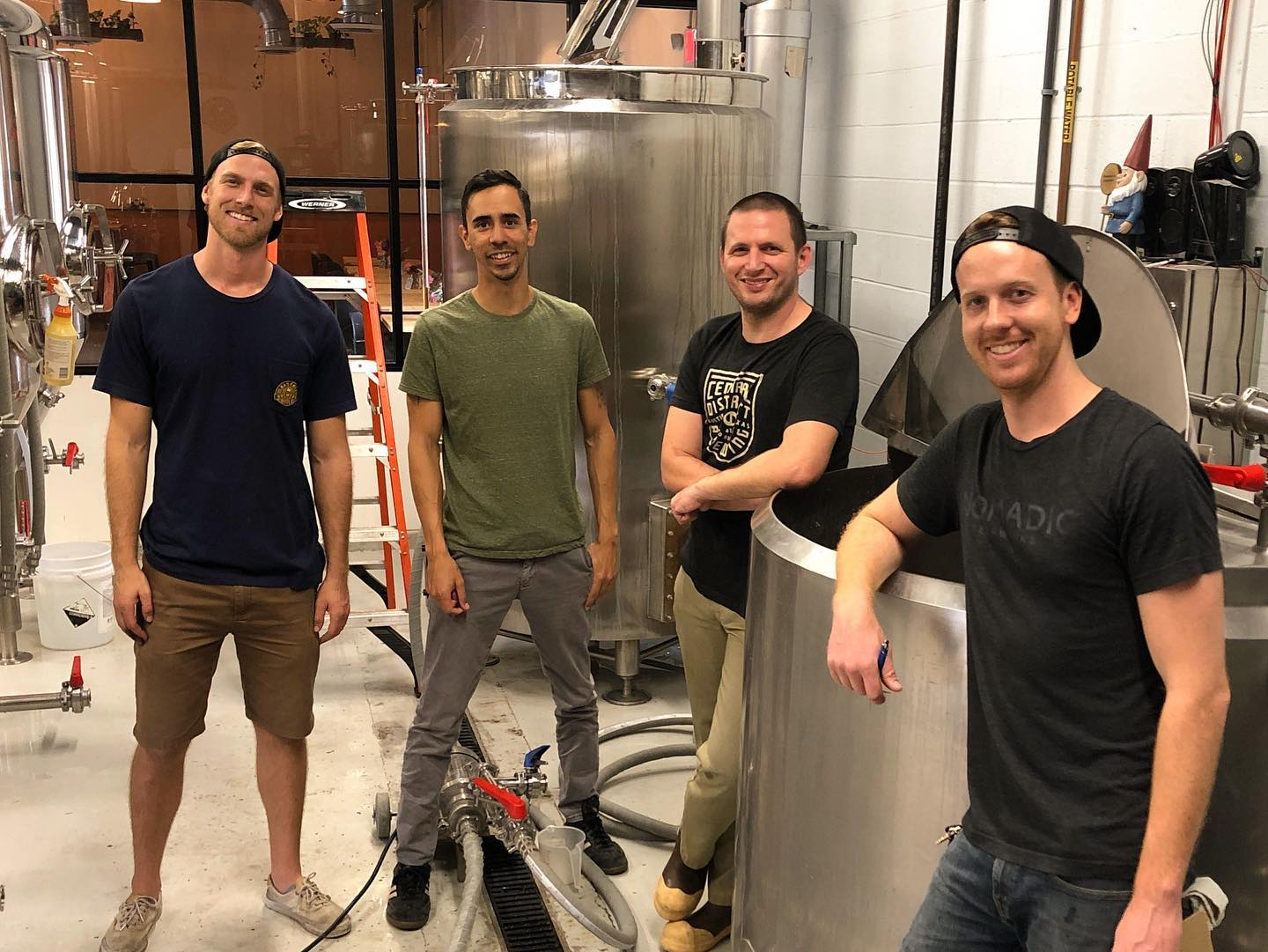 Owners of Nomadic Beerworks and Central District Brewing working in brewhouse